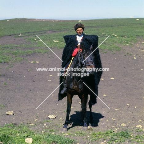 cossack riding Kabardine horse in Caucasus mountains