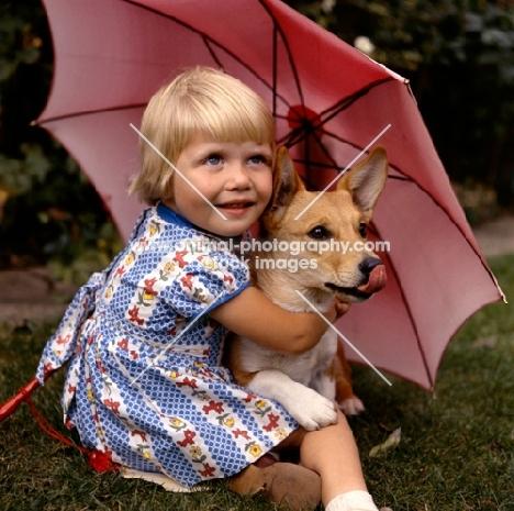 girl and corgi under parasol