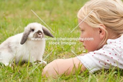 girl with mini lop rabbit