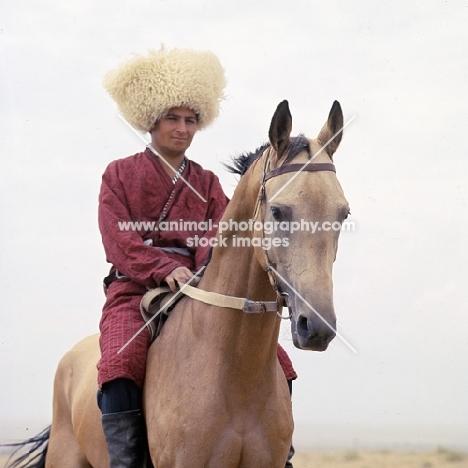 polotli, akhal teke horse, turkmen rider in traditional clothes