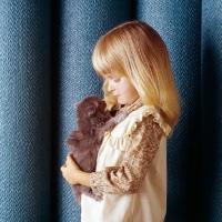 Picture of child holding Persian tortoiseshell kitten